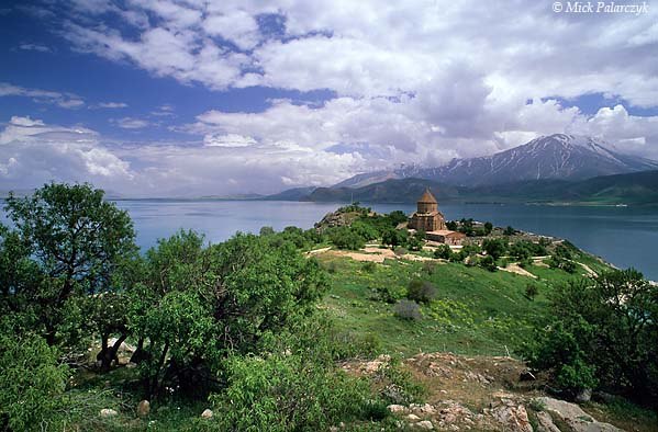 [TURKEY.EAST 27920] 'View of Akdamar Island-1.'  	Akdamar is a small island in Lake Van situated about 3 km from the southern shore. Its principal building is the Cathedral of the Holy Cross, built around 915 AD by king Gacik I Artsruni of the Armenian Vaspurakan kingdom who established one of his residences on the island. Photo Mick Palarczyk.