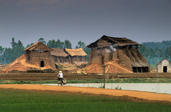 [VIETNAM.NORTH 21.257] 'Brick factories near Hà Dông.'  	Brick factories near Hà Dông make use of the clay that is to be found in the Red River valley west of Hanoi. Photo Mick Palarczyk