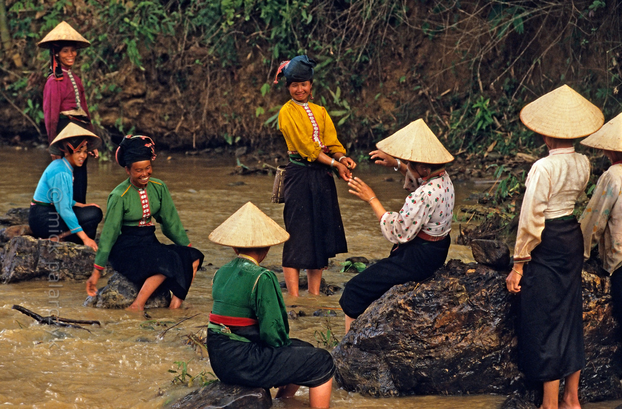[VIETNAM.NORTH 21.307] 'Black Thái women.'  After hard work on the construction of a dam these Black Thái women have a rest in a tributary of the Nam La River, south of So'n La.. Photo Mick Palarczyk.