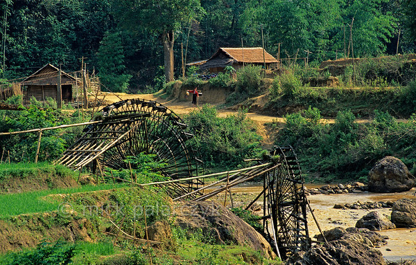 [VIETNAM.NORTH 21.284] 'Irrigation wheels.'  	Huge bamboo made irrigation wheels are driven by the power of a tributary of the Nam La River, south of So'n La. Photo Mick Palarczyk.