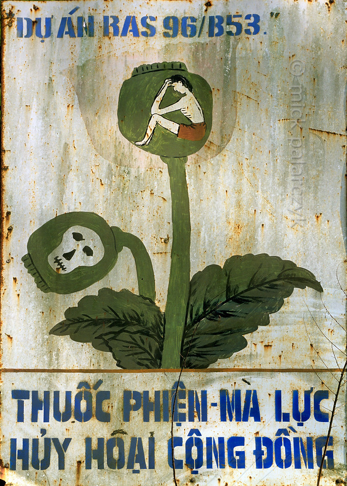 "[VIETNAM.NORTH 21.274] 'Opium is destructive.'  	A road sign near Môc Châu reads: ""opium is destructive to the community."" Photo Mick Palarczyk."