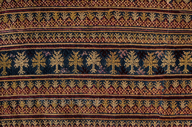 [VIETNAM.NORTH 21.415] 'Embroidered universe.'  Embroidered backflap (Luy Khia) of the jacket of a Red Dao woman. The embroidery on the clothes of the Red Dao mountain tribe is a geometrical translation of the natural world that the tribe inhabits: trees, flowers, animals, people and stars. Photo Mick Palarczyk