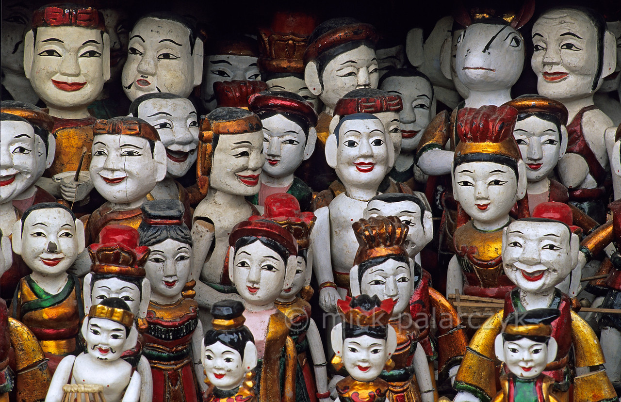 [VIETNAM.NORTH 21.564] 'Water marionettes.'  Shop with water marionettes in Hanoi. Water puppetry (roi nuoc) is a uniquely Vietnamese form of theatre that draws its plots from legends and historical sources. It is at least as old as the 12th century AD and originated in the wet environments of the Red River valley. In a traditional water puppet theatre the marionettes are manipulated by way of wooden levers that remain concealed under the surface of the water. Photo Mick Palarczyk