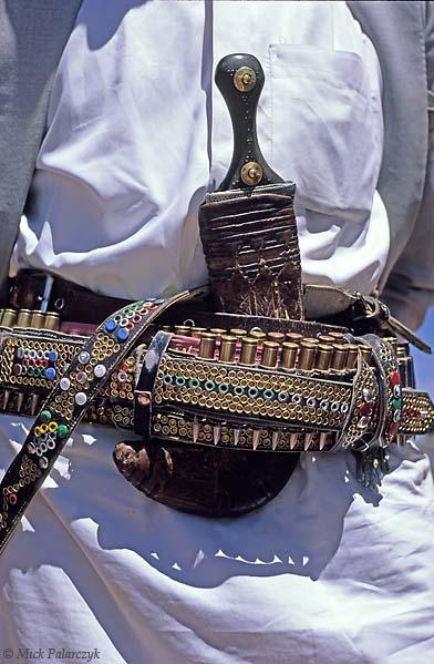[YEMEN.NORTH 26365] 'Man with jambiya-2.'  Most men in Yemen wear a jambiya, a ceremonial dagger which is a symbol af manly pride. Photo Mick Palarczyk.