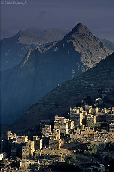 [YEMEN.NORTH 26279] 'Manakha tower houses-2.'  The tower houses of Manakha, a small town in the Jebel Haras mountains, catch the first rays of the sun. Photo Mick Palarczyk.
