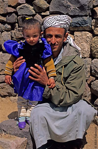 [YEMEN.NORTH 26309] 'Father and daughter in Al Jebel.'  A father proudly shows his young daughter in Al Jebel village (in the Jebel Haras mountains south of Manakha.) Photo Mick Palarczyk.