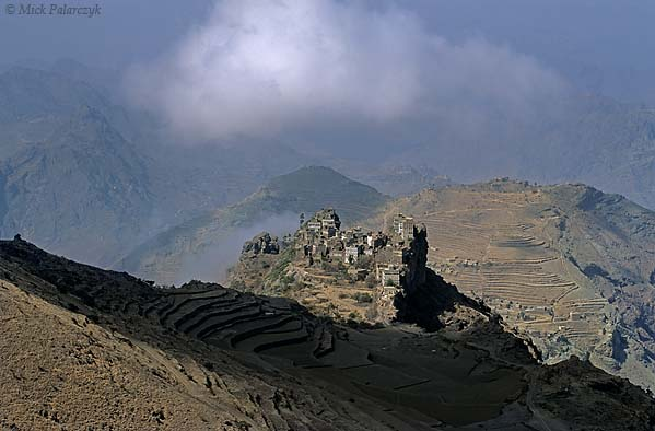 [YEMEN.NORTH 26313] 'Kahel village-2.'  The tower houses of Kahel village sit on a craggy rock pedestal in the Jebel Haras mountains south of Manakha. Photo Mick Palarczyk.