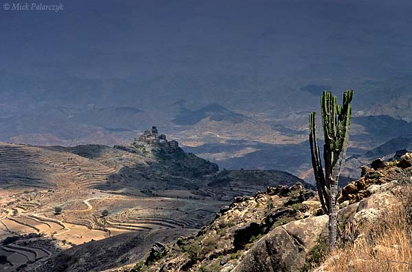 [YEMEN.NORTH 26327] 'Cloud shadows near Shargi.'  In the rainy season thunderstorms build up during the afternoon over the Jebel Haras mountains. Sunlight playing through the clouds give the landscape a dramatic appearance, as here around the village of Shargi, southeast of Manakha. Photo Mick Palarczyk.