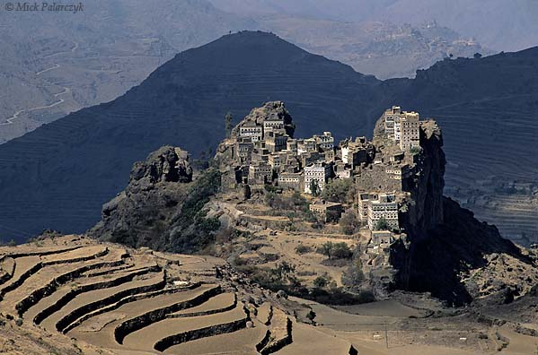 [YEMEN.NORTH 26311] 'Kahel village-1.'  The tower houses of Kahel village sit on a craggy rock pedestal in the Jebel Haras mountains south of Manakha. Photo Mick Palarczyk.
