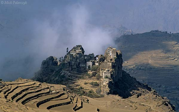 [YEMEN.NORTH 26315] 'Kahel village-3.'  The tower houses of Kahel village sit on a craggy rock pedestal in the Jebel Haras mountains south of Manakha. Photo Mick Palarczyk.