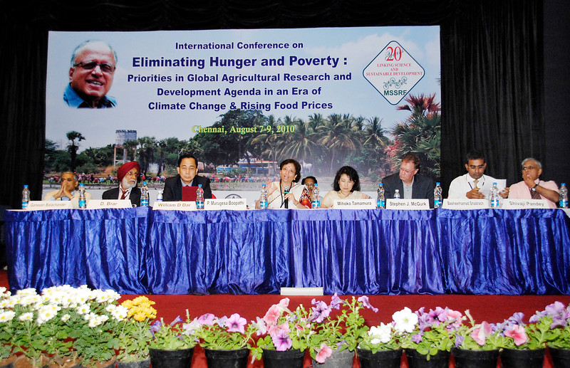 """A three days International Conference on """"Eliminating Hunger and Poverty: Priorities in Global Agricultural Research and Development Agenda in an Era of Climate Change and Rising Food Prices"""", August 7 - 9, 2010 was Inaugurated at the Chennai Trade Centre on August 7, 2010. This Conference is to mark the 85th Birthday of Prof. M S Swaminathan. Hon'ble Chief Minister of Tamil Nadu Dr Kalaignar M Karunanidhi inaugurated and released the M S Swaminathan Research Foundation's Annual Report for the year 2009-10. Hon'ble Chief Minister of Andhra Pradesh Sri K Rosaiah delivered the special Address. Mr. Ibrahim Didi, Minister of Fisheries and Agriculture, Maldives received the first copy of the Annual Report. <br /> <br /> The backdrop used is a picture shot by me in rural Tamil Nadu."""