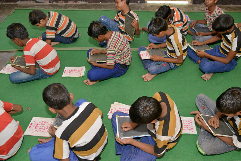 Mukti Ashram is a safe haven for rescued child/bonded labourers till they are repatriated to their parents/guardians. Repatriation may take 6 to 8 weeks till the legal procedures are completed. Children attending Non Formal Education class at Mukti Ashram. A non-Formal education curriculum has been developed for children who had never been in school to teach them simple mathematics and alphabets (Hindi & English). <br /> <br /> Bachpan Bachao Andolan (BBA) is India's pioneering child rights organisation working towards the elimination of all forms of exploitation against children and for free and compulsory education of all children. Over the years BBA has rescued thousands of victims of trafficking, slavery and child labour. Victims are often malnourished, paid meagre wages, if at all, and work extremely long hours in difficult environments.
