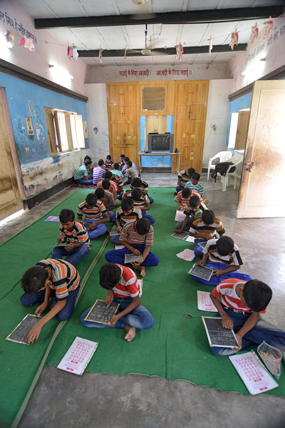 Children learning to write the Hindi alphabets at Mukti Ashram.<br />  <br /> Mukti Ashram is a safe haven for rescued child/bonded labourers till they are repatriated to their parents/guardians. Repatriation may take 6 to 8 weeks till the legal procedures are completed. Children attending Non Formal Education class at Mukti Ashram. A non-Formal education curriculum has been developed for children who had never been in school to teach them simple mathematics and alphabets (Hindi & English). <br /> <br /> Bachpan Bachao Andolan (BBA) is India's pioneering child rights organisation working towards the elimination of all forms of exploitation against children and for free and compulsory education of all children. Over the years BBA has rescued thousands of victims of trafficking, slavery and child labour. Victims are often malnourished, paid meagre wages, if at all, and work extremely long hours in difficult environments.