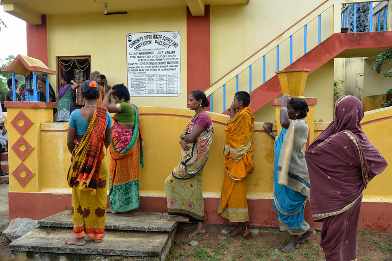 Women get together outside the meeting space at Community Piped Water Supply and Sanitation Project at village Haradango in District Ganjam by Gram Vikas, Mohuda, Ganjam.<br /> <br /> Gram Vikas' founders came to Orissa in the early 1970s as student volunteers to serve victims of a devastating cyclone. Their extensive activism and relief work motivated them to form Gram Vikas, which was registered on January 22, 1979, and currently serves more than 3,89,333 people in 1196 habitations of 25 districts in Odisha. Through its direct outreach programmes Gram Vikas works in 943 villages across 23 districts.