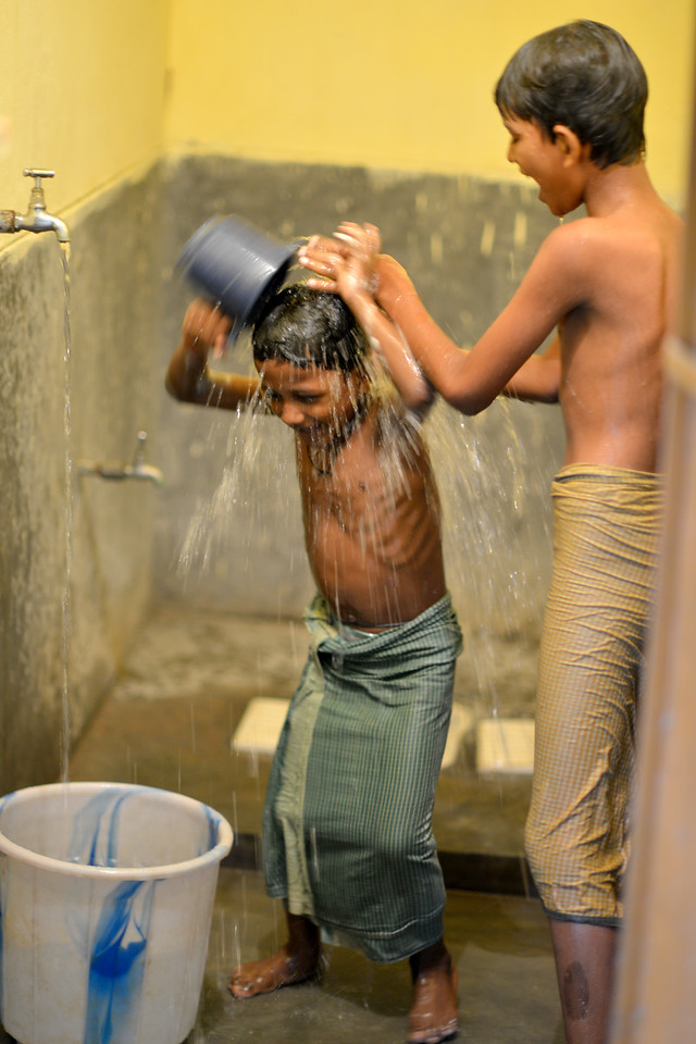 Brothers G.Santosh and B.Santosh at Jaleripentho village enjoy a bath together under running, clean tap water installed by Gram Vikas.<br /> <br /> Gram Vikas' founders came to Orissa in the early 1970s as student volunteers to serve victims of a devastating cyclone. Their extensive activism and relief work motivated them to form Gram Vikas, which was registered on January 22, 1979, and currently serves more than 3,89,333 people in 1196 habitations of 25 districts in Odisha. Through its direct outreach programmes Gram Vikas works in 943 villages across 23 districts.
