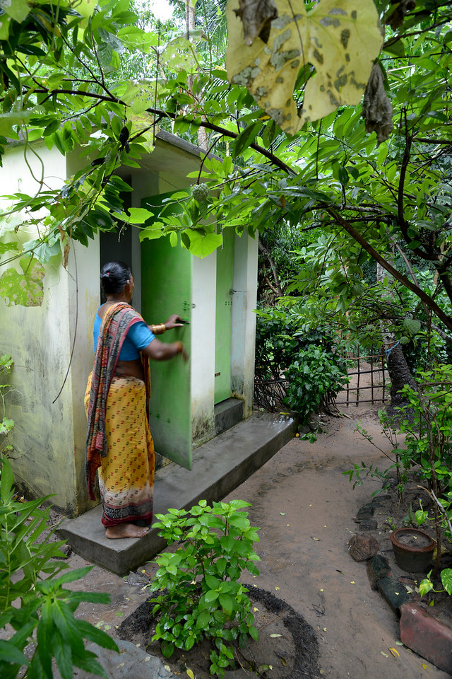A lady using the toilet at the back of the house built by Gram Vikas in Jaleripentho village.<br /> <br /> According to the data available (2001) in Orissa, 80% of the instances of morbidity and mortality cases in rural areas are caused by water-borne diseases. Less than 7% of rural households have access to safe sanitation, less than 20% of rural population has access to protected water and no more than 1% to piped water supply.