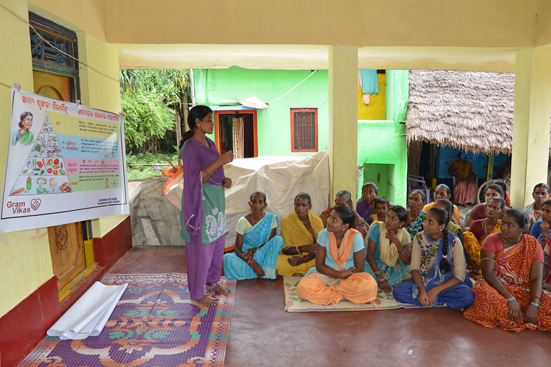 Jashoda from Gram Vikas conducting a community educational programme at Jaleripentho village. Villagers are taught about nutrition, hygiene and diet. <br /> <br /> Gram Vikas' founders came to Orissa in the early 1970s as student volunteers to serve victims of a devastating cyclone. Their extensive activism and relief work motivated them to form Gram Vikas, which was registered on January 22, 1979, and currently serves more than 3,89,333 people in 1196 habitations of 25 districts in Odisha.