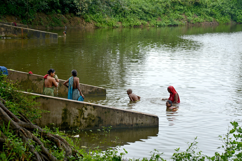 Women washing and bathing in a water body near Jaleripentho village. Villages which are not part of Gram Vikas' programme do not have running and clean water. Men and women bath and wash in the same water on either sides of the banks.<br /> <br /> In villages where Gram Vikas work, there is clean running water. Gram Vikas' founders came to Orissa in the early 1970s as student volunteers to serve victims of a devastating cyclone. Their extensive activism and relief work motivated them to form Gram Vikas, which was registered on January 22, 1979, and currently serves more than 3,89,333 people in 1196 habitations of 25 districts in Odisha.