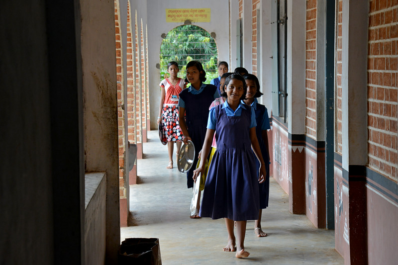 Gram Vikas Residential School, Kankia.<br /> <br /> Literacy rates in rural areas is 58% (71% for males and 44% for females) as compared to the state average of 63% (76% males and 50% females). The state also suffers from high rates of infant and maternal mortality. <br /> <br /> Gram Vikas' founders came to Orissa in the early 1970s as student volunteers to serve victims of a devastating cyclone. They registered in 1979, and currently serves more than 3,89,333 people in 1196 habitations of 25 districts in Odisha.<br /> <br /> Through its direct outreach programmes Gram Vikas works in 943 villages across 23 districts covering 59,132 families of which 39% are adivasis, 14% are dalits and the remainder are from general castes, mostly poor and marginal farmers.