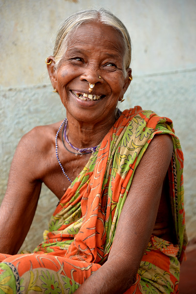 Tribal lady sitting outside her house at the first settlement block provided by Gram Vikas.<br /> Through its direct outreach programmes Gram Vikas works in 943 villages across 23 districts covering 59,132 families of which 39% are adivasis, 14% are dalits and the remainder are from general castes, mostly poor and marginal farmers.