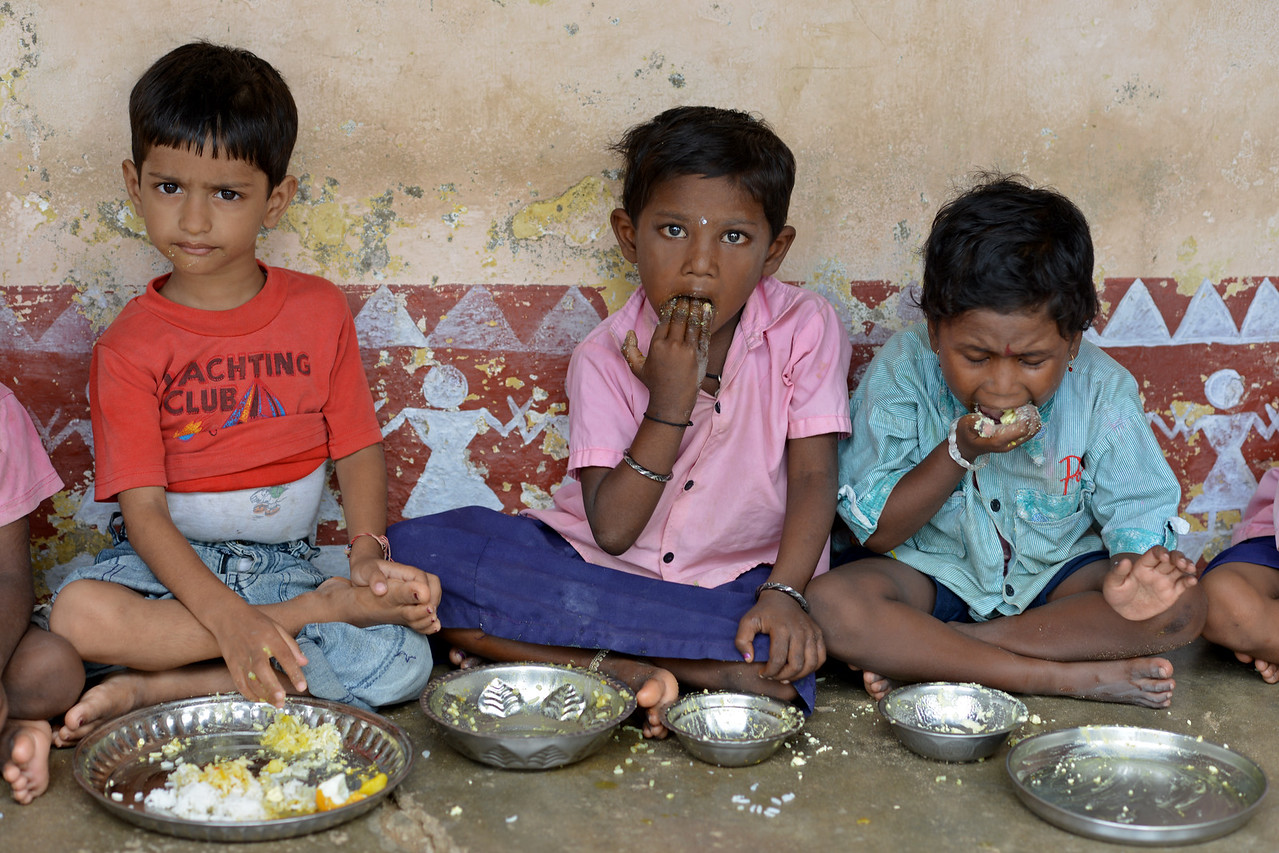 Dev, Devika and Usaha in Jaleripentho village enjoy their mid-day meals. Clean tap water for the school by Gram Vikas ensures that the children are healthy and safe.<br /> <br /> Gram Vikas' founders came to Orissa in the early 1970s as student volunteers to serve victims of a devastating cyclone. Their extensive activism and relief work motivated them to form Gram Vikas, which was registered on January 22, 1979, and currently serves more than 3,89,333 people in 1196 habitations of 25 districts in Odisha. Through its direct outreach programmes Gram Vikas works in 943 villages across 23 districts.