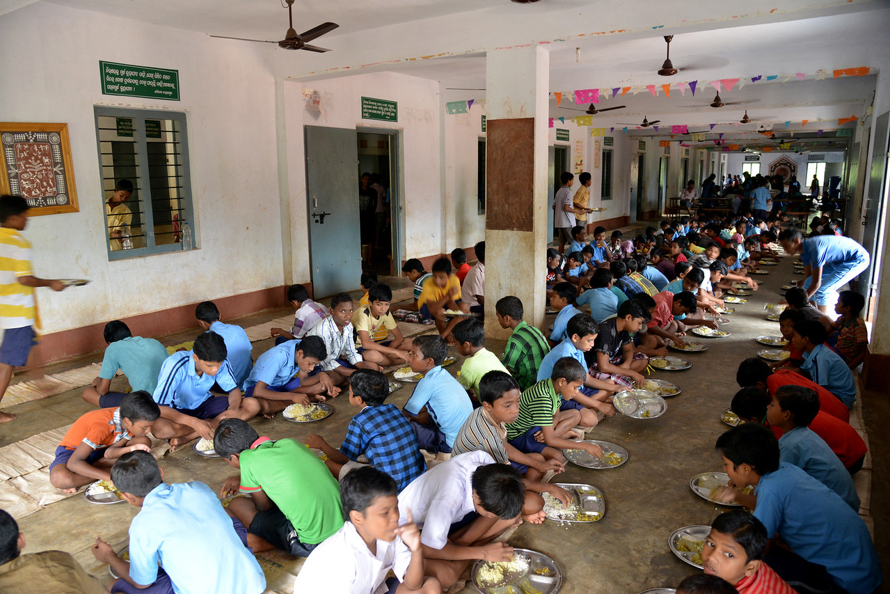 Mid-day meals at Gram Vikas Residential School, Kankia, Ganjam, Orissa.<br /> The school has an excellent academic record of 100% pass rate at the annual HSC examination. Regular health check ups are conducted and the students excel at sports such as weight lifting.<br /> <br /> Literacy rates in rural areas is 58% (71% for males and 44% for females) as compared to the state average of 63% (76% males and 50% females). The state also suffers from high rates of infant and maternal mortality. <br /> <br /> Gram Vikas' founders came to Orissa in the early 1970s as student volunteers to serve victims of a devastating cyclone. They registered in 1979, and currently serves more than 3,89,333 people in 1196 habitations of 25 districts in Odisha. Through its direct outreach programmes Gram Vikas works in 943 villages across 23 districts covering 59,132 families of which 39% are adivasis, 14% are dalits and the remainder are from general castes, mostly poor and marginal farmers.