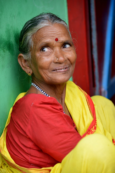 Lady sitting outside her house at the first settlement block provided by Gram Vikas.<br /> <br /> Through its direct outreach programmes Gram Vikas works in 943 villages across 23 districts covering 59,132 families of which 39% are adivasis, 14% are dalits and the remainder are from general castes, mostly poor and marginal farmers.