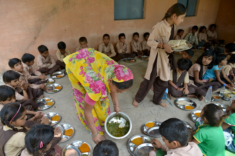 Children having their mid-day meals at Fawda.<br /> <br /> Jan Sahas is a social and community based organization that is committed to protection of <br /> human rights and development of socially excluded communities through abolishing the all <br /> kind of slavery, social exclusion, atrocities and all forms of discrimination based on <br /> caste, class and gender.