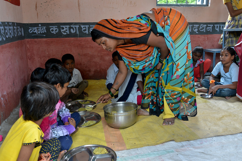 Kiranji Bai, a liberated manual scavenger lady serving food at the Anganwadi/ICDS children center at Bhorasa village. Earlier due to segregation they would not be allowed to even come near let alone touch food being eaten by all communities.<br /> <br /> Jan Sahas is a social and community based organization that is committed to protection of <br /> human rights and development of socially excluded communities through abolishing the all <br /> kind of slavery, social exclusion, atrocities and all forms of discrimination based on <br /> caste, class and gender.