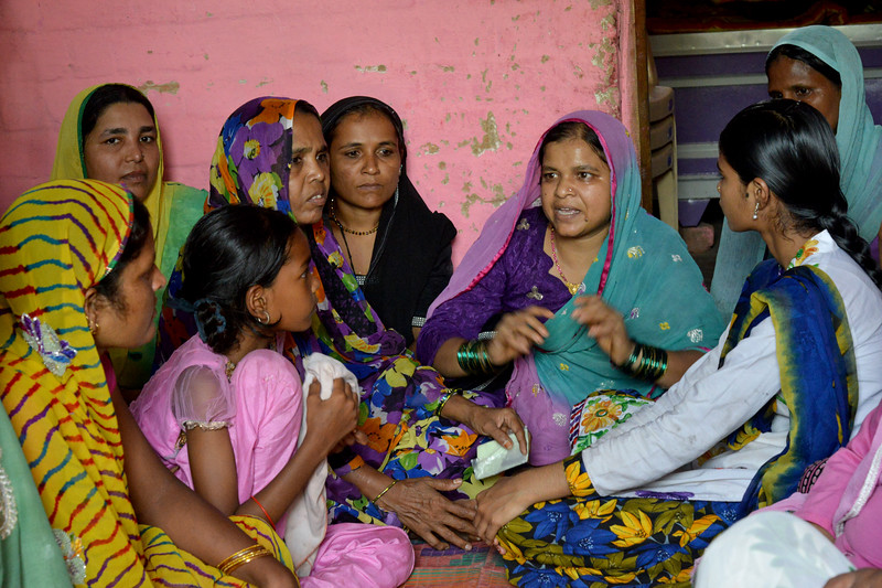 Meeting with children and liberated manual scavenger women at the ICDS children center at Bhorasa village.<br /> <br /> Jan Sahas is a social and community based organization that is committed to protection of <br /> human rights and development of socially excluded communities through abolishing the all <br /> kind of slavery, social exclusion, atrocities and all forms of discrimination based on <br /> caste, class and gender.