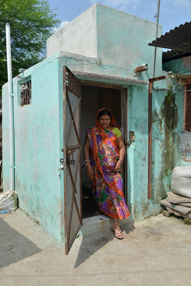 Liberated manual scavenger lady at Bhorasa village demonstrates how the new flush water toilets built by the community with Government funding by Jan Sahas' intervention has changed their lives.<br /> <br /> Jan Sahas is a social and community based organization that is committed to protection of <br /> human rights and development of socially excluded communities through abolishing the all <br /> kind of slavery, social exclusion, atrocities and all forms of discrimination based on <br /> caste, class and gender.