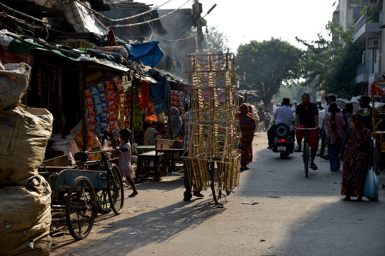 Seemapuri, Delhi street view where Mobile Creches operates one of its centres.<br /> <br /> Mobile Creches works with birth to 12 year old children living on the construction sites and slums of Delhi(NCR) since 1969. Integrated Daycare Centers for children on construction sites are run. Mobile Creches has so far reached out to 7,50,000 children, trained 6,500 women as childcare workers, run 650 daycare centres and partnered with 200 builders.<br /> <br /> Mobile Creches runs daycares centres where children are provided education, nutrition and healthcare. Community-women and NGOs are trained to provide care and speak-up for the child. The years of experience along with strong-networks helps in the advocay for policy-change.