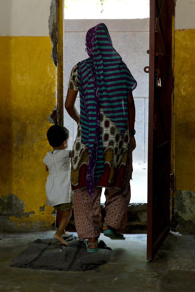 Mothers come to take their children home at the end of the day from the Mobile Creches, Seemapuri Centre.<br /> <br /> Mobile Creches works with birth to 12 year old children living on the construction sites and slums of Delhi(NCR) since 1969. Integrated Daycare Centers for children on construction sites are run. Mobile Creches has so far reached out to 7,50,000 children, trained 6,500 women as childcare workers, run 650 daycare centres and partnered with 200 builders.<br /> <br /> Mobile Creches runs daycares centres where children are provided education, nutrition and healthcare. Community-women and NGOs are trained to provide care and speak-up for the child. The years of experience along with strong-networks helps in the advocay for policy-change.
