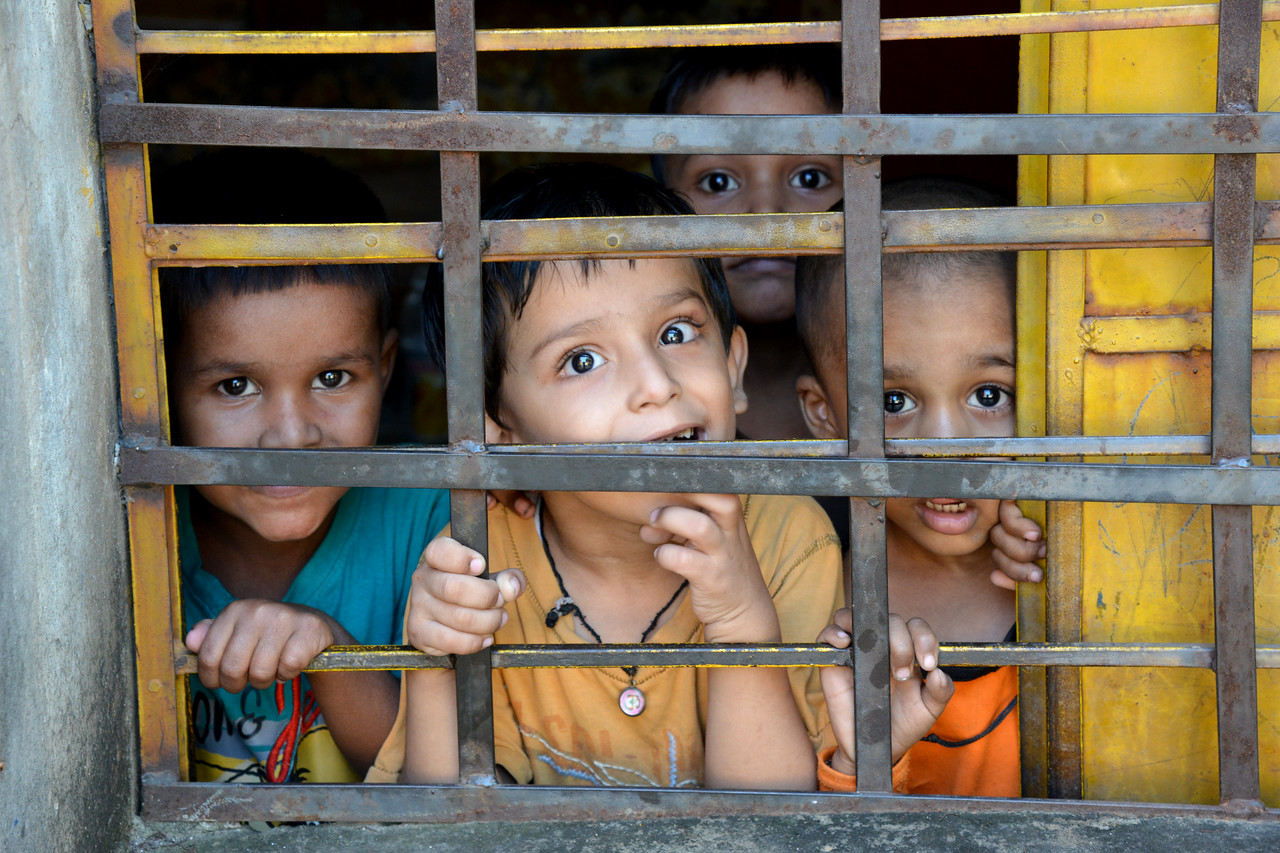 Children playing in the Mobile Creches run Centre in Seemapuri, Delhi.<br /> <br /> Mobile Creches works with birth to 12 year old children living on the construction sites and slums of Delhi(NCR) since 1969. Integrated Daycare Centers for children on construction sites are run. Mobile Creches has so far reached out to 7,50,000 children, trained 6,500 women as childcare workers, run 650 daycare centres and partnered with 200 builders.<br /> <br /> Mobile Creches runs daycares centres where children are provided education, nutrition and healthcare. Community-women and NGOs are trained to provide care and speak-up for the child. The years of experience along with strong-networks helps in the advocay for policy-change.