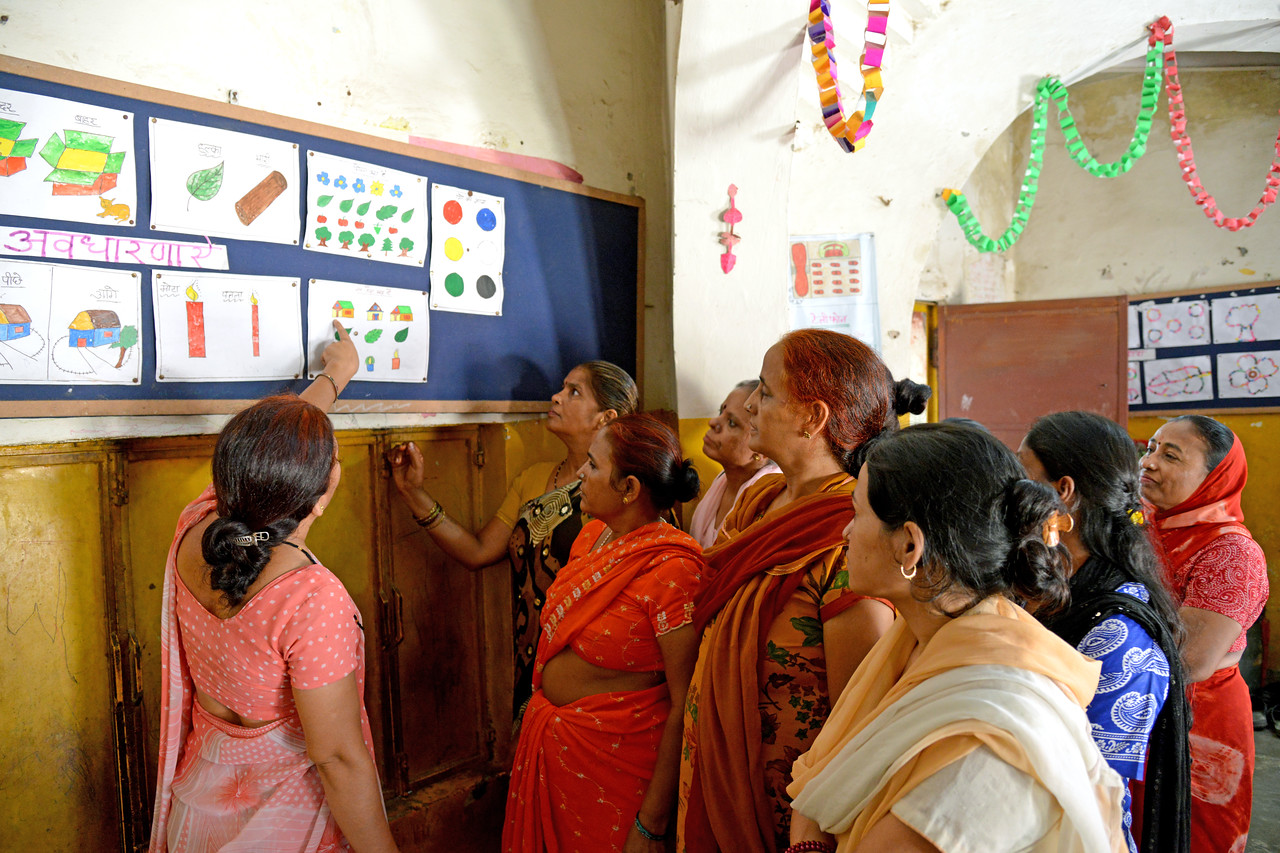 Training the trainers at the Mobile Creches, Seemapuri Centre.<br /> <br /> Mobile Creches works with birth to 12 year old children living on the construction sites and slums of Delhi(NCR) since 1969. Integrated Daycare Centers for children on construction sites are run. Mobile Creches has so far reached out to 7,50,000 children, trained 6,500 women as childcare workers, run 650 daycare centres and partnered with 200 builders.<br /> <br /> Mobile Creches runs daycares centres where children are provided education, nutrition and healthcare. Community-women and NGOs are trained to provide care and speak-up for the child. The years of experience along with strong-networks helps in the advocay for policy-change.