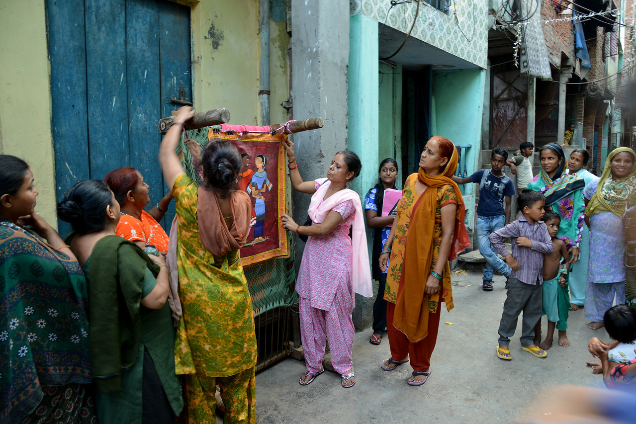 Community awareness meeting being conducted by Mobile Creches in the streets at Seemapuri, Delhi.<br /> <br /> Mobile Creches works with birth to 12 year old children living on the construction sites and slums of Delhi(NCR) since 1969. Integrated Daycare Centers for children on construction sites are run. Mobile Creches has so far reached out to 7,50,000 children, trained 6,500 women as childcare workers, run 650 daycare centres and partnered with 200 builders.<br /> <br /> Mobile Creches runs daycares centres where children are provided education, nutrition and healthcare. Community-women and NGOs are trained to provide care and speak-up for the child. The years of experience along with strong-networks helps in the advocay for policy-change.