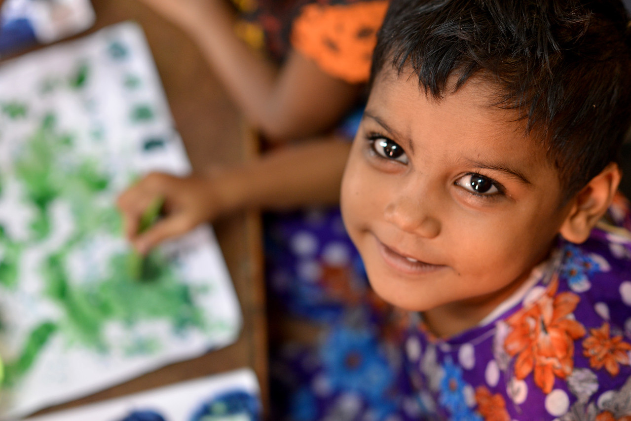 Children painting at the Mobile Creches, Seemapuri Centre.<br /> <br /> Mobile Creches works with birth to 12 year old children living on the construction sites and slums of Delhi(NCR) since 1969. Integrated Daycare Centers for children on construction sites are run. Mobile Creches has so far reached out to 7,50,000 children, trained 6,500 women as childcare workers, run 650 daycare centres and partnered with 200 builders.<br /> <br /> Mobile Creches runs daycares centres where children are provided education, nutrition and healthcare. Community-women and NGOs are trained to provide care and speak-up for the child. The years of experience along with strong-networks helps in the advocay for policy-change.