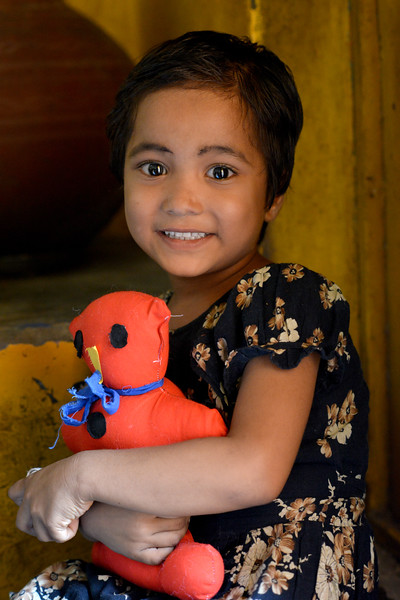 Young girl clutching her toy at the Mobile Creches, Seemapuri Centre.<br /> <br /> Mobile Creches works with birth to 12 year old children living on the construction sites and slums of Delhi(NCR) since 1969. Integrated Daycare Centers for children on construction sites are run. Mobile Creches has so far reached out to 7,50,000 children, trained 6,500 women as childcare workers, run 650 daycare centres and partnered with 200 builders.<br /> <br /> Mobile Creches runs daycares centres where children are provided education, nutrition and healthcare. Community-women and NGOs are trained to provide care and speak-up for the child. The years of experience along with strong-networks helps in the advocay for policy-change.