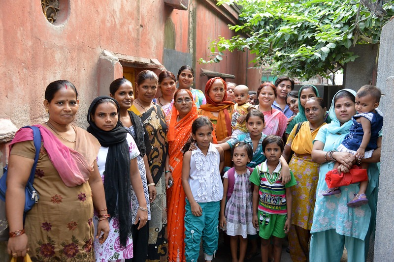 Staff and mothers with their children at the Mobile Creches run Centre in Seemapuri, Delhi.<br /> <br /> Mobile Creches works with birth to 12 year old children living on the construction sites and slums of Delhi(NCR) since 1969. Integrated Daycare Centers for children on construction sites are run. Mobile Creches has so far reached out to 7,50,000 children, trained 6,500 women as childcare workers, run 650 daycare centres and partnered with 200 builders.<br /> <br /> Mobile Creches runs daycares centres where children are provided education, nutrition and healthcare. Community-women and NGOs are trained to provide care and speak-up for the child. The years of experience along with strong-networks helps in the advocay for policy-change.