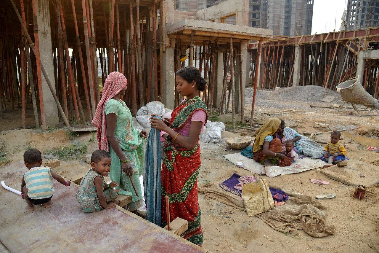 New labourers arrive at the construction site. If the children don't go to the Mobile Creches Centre they would be spending the day in this location at the construction site itself.<br /> <br /> <br /> <br /> Mobile Creches works with birth to 12 year old children living on the construction sites and slums of Delhi(NCR) since 1969. Integrated Daycare Centers for children on construction sites are run. Mobile Creches has so far reached out to 7,50,000 children, trained 6,500 women as childcare workers, run 650 daycare centres and partnered with 200 builders.<br /> <br /> Mobile Creches runs daycares centres where children are provided education, nutrition and healthcare. Community-women and NGOs are trained to provide care and speak-up for the child. The years of experience along with strong-networks helps in the advocacy for policy-change.