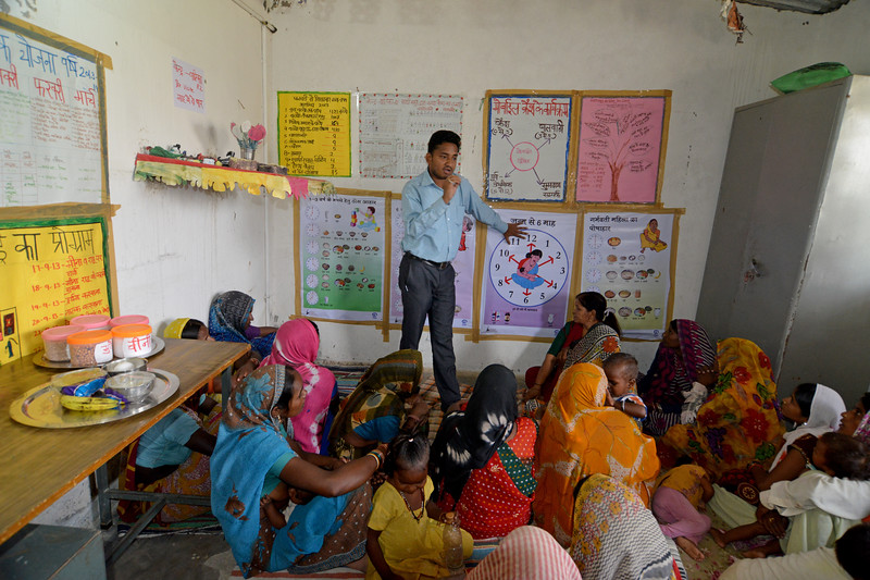 Govinda from Mobile Creches conducting a meeting for young mothers on child health & nutrition.<br /> <br /> Mobile Creches, Vatika-83, Gurgaon, Delhi, NCR.<br /> <br /> <br /> <br /> Mobile Creches works with birth to 12 year old children living on the construction sites and slums of Delhi(NCR) since 1969. Integrated Daycare Centers for children on construction sites are run. Mobile Creches has so far reached out to 7,50,000 children, trained 6,500 women as childcare workers, run 650 daycare centres and partnered with 200 builders.<br /> <br /> Mobile Creches runs daycares centres where children are provided education, nutrition and healthcare. Community-women and NGOs are trained to provide care and speak-up for the child. The years of experience along with strong-networks helps in the advocacy for policy-change.