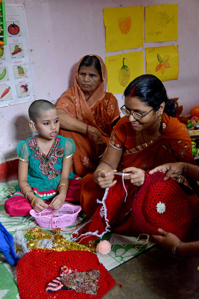 Ms Pushpa Devi who is a deafblind adult, learnt tailoring and shows her works. Nabisha, 9 years old, and her mother are drawn to it. At this centre, children and their parents are trained in everyday activities, mobility, reading & writing by Nav Bharat Jagriti Kendra (NBJK) for deafblind children who have both hearing and visual disability.<br /> <br /> Nav Bharat Jagriti Kendra (NBJK) was established in 1971 by four engineering graduates who <br /> were sensitive to the causes of disparity, exploitation and poverty with an aim to <br /> establish a just society. Today they are the leading non-profit organization in Jharkhand <br /> running educational institution and health facilities.