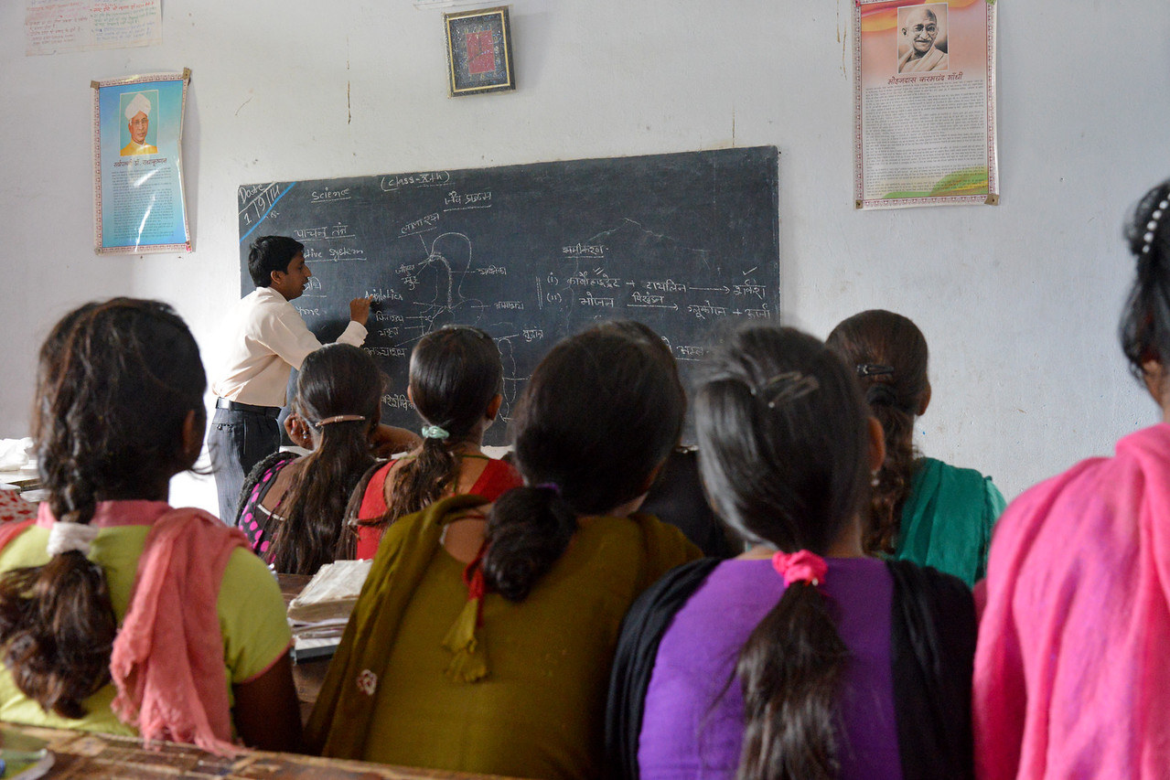 Remedial Coaching Centre (RCC) by Nav Bharat Jagriti Kendra (NBJK) at the Government Primary School teaching Digestive System to the Biology class of the 10th standard. This classes supplements the regular education. Due to poor teaching at government schools, it has been observed that students reaching class 10th do not know even fundamental of subjects like Maths, Science and English. NBJK has felt the gravity of this problem related to rural school children and decided to support them to furnish their education with quality by opening of Remedial Coaching Centres (RCCs) in Hazaribag district of Jharkhand.<br /> <br /> Nav Bharat Jagriti Kendra (NBJK) was established in 1971 by four engineering graduates who <br /> were sensitive to the causes of disparity, exploitation and poverty with an aim to <br /> establish a just society. Today they are the leading non-profit organization in Jharkhand <br /> running educational institution and health facilities.