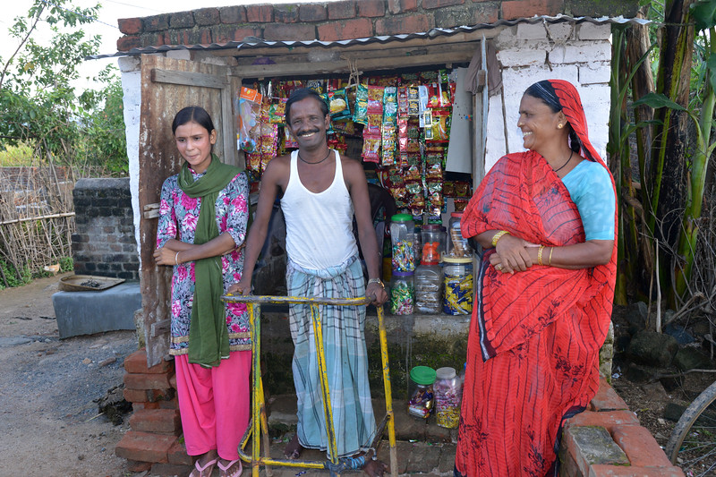 Beneficiary of Nav Bharat Jagriti Kendra (NBJK) SWABAL programme now runs a small local shop. Standing tall with his wife and daughter she shares show the programme was helpful to him.<br /> <br /> Nav Bharat Jagriti Kendra (NBJK) was established in 1971 by four engineering graduates who <br /> were sensitive to the causes of disparity, exploitation and poverty with an aim to <br /> establish a just society. Today they are the leading non-profit organization in Jharkhand <br /> running educational institution and health facilities.