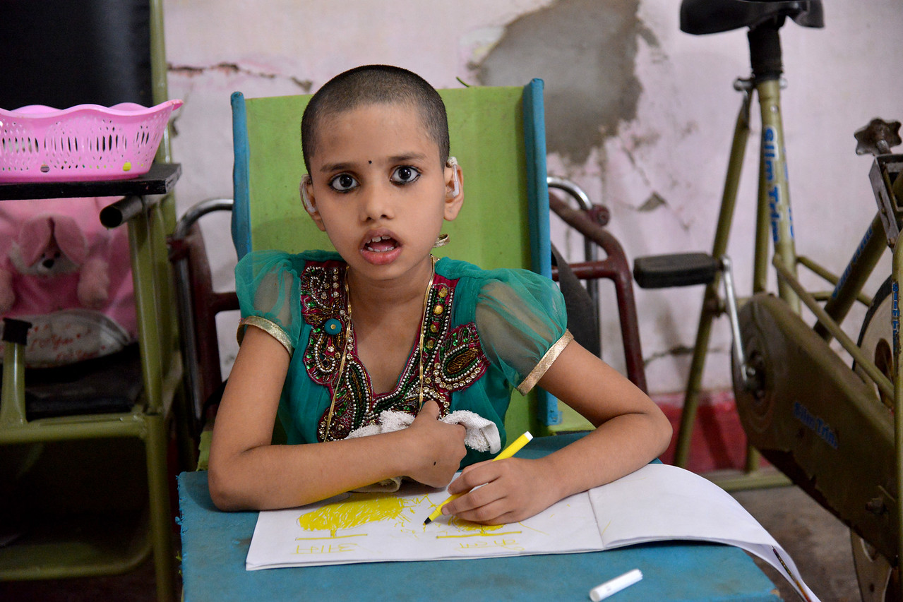 Nabisha, 9 years old, has both visual and auditory disability. She and her mother Musarrat Khatun come to Nav Bharat Jagriti Kendra (NBJK) to learn everyday activity skills, mobility, reading, colouring and writing.<br />  <br /> Nav Bharat Jagriti Kendra (NBJK) was established in 1971 by four engineering graduates who <br /> were sensitive to the causes of disparity, exploitation and poverty with an aim to <br /> establish a just society. Today they are the leading non-profit organization in Jharkhand <br /> running educational institution and health facilities.