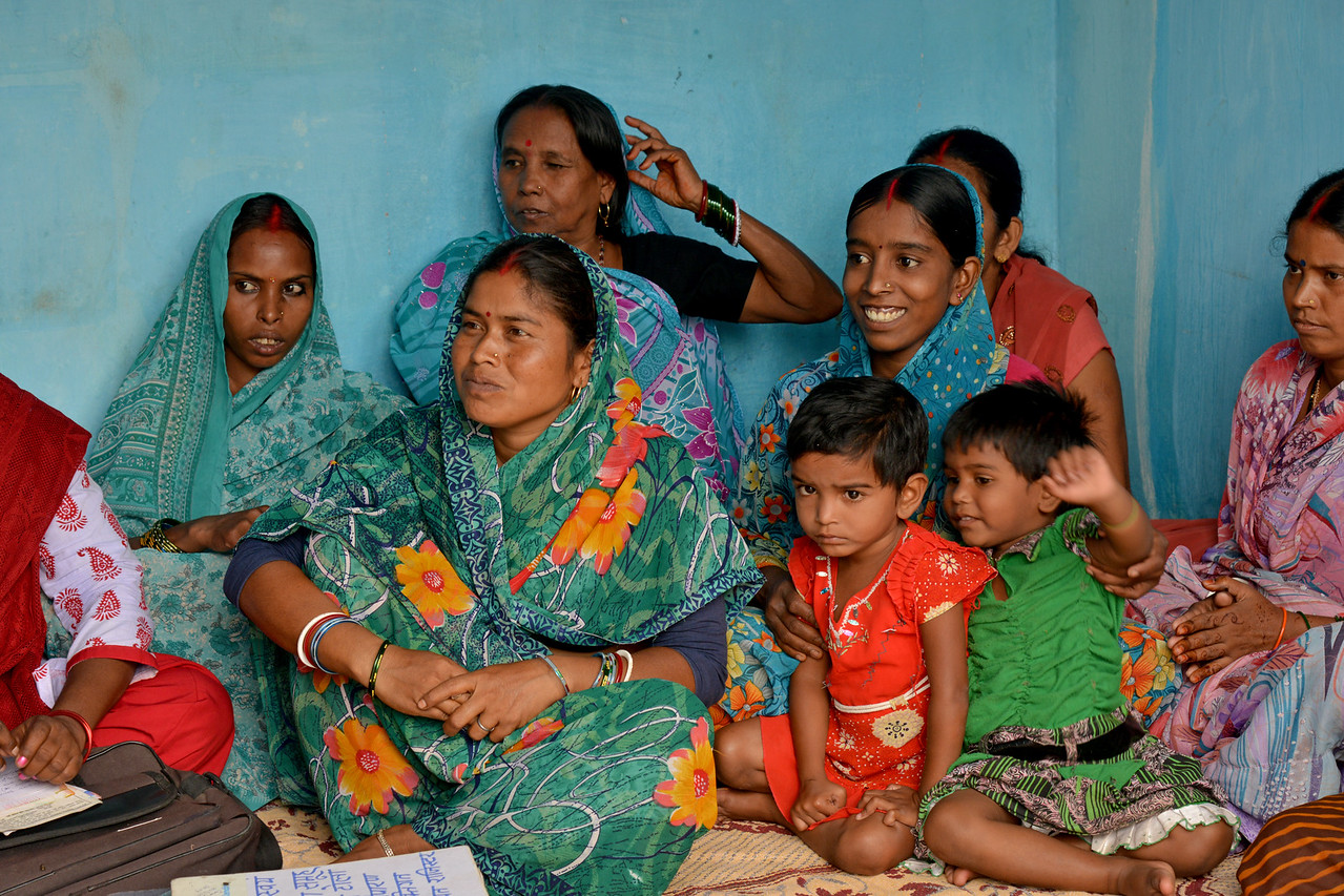 Women's group meeting in the village along with Satish Girija, Secretary of Nav Bharat Jagriti Kendra (NBJK). Small Group Support (SGS) plays a vital role, both in organising the people and filling the gaps in service delivery where the government does not reach. NBJK has been working to strengthen the groups and supporting committed social activist so that they can work to improve the social-economic development of marginalised communities.<br /> <br /> Nav Bharat Jagriti Kendra (NBJK) was established in 1971 by four engineering graduates who <br /> were sensitive to the causes of disparity, exploitation and poverty with an aim to <br /> establish a just society. Today they are the leading non-profit organization in Jharkhand <br /> running educational institution and health facilities.