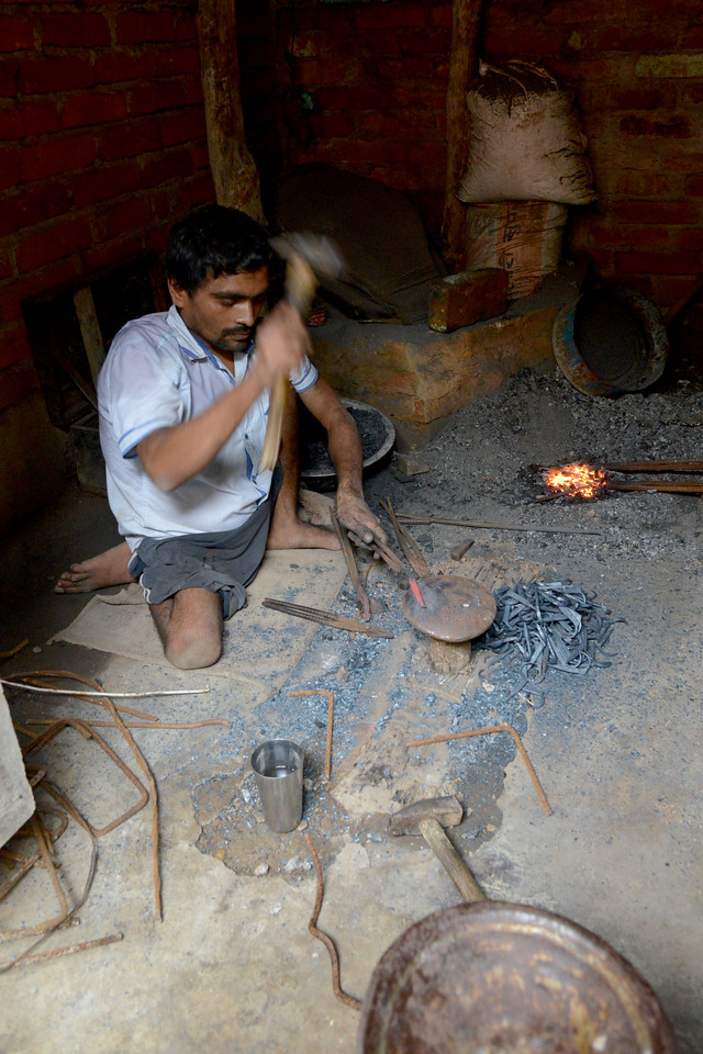 Narayan Vishkarma has a below the waist impairment and mobility issues. He was trained by Nav Bharat Jagriti Kendra (NBJK) under the SWABAL programme and now is a blacksmith earning an independent livelihood.<br /> <br /> Nav Bharat Jagriti Kendra (NBJK) was established in 1971 by four engineering graduates who <br /> were sensitive to the causes of disparity, exploitation and poverty with an aim to <br /> establish a just society. Today they are the leading non-profit organization in Jharkhand <br /> running educational institution and health facilities.