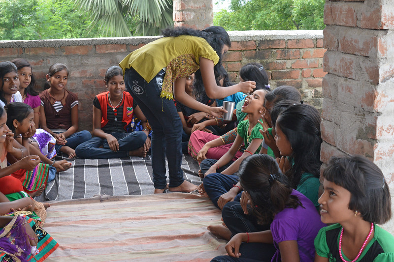 "Adolescent girls group ""Maa Saraswati"" through role playing learn about diarrhea and preparing ORS (Oral rehydration Salts) at Raghunathganj-1, Bagha Village.<br /> <br /> Reach India believe that health, hope and dignity are three basic rights for every woman and every family. Even more critical for those living in extreme poverty.<br /> <br /> Reach India's network of local service centres train thousands of local organisations, which in turn train millions of women and girls in self-help and other community groups. Reach's interactive training provides vital information on health, livelihoods and family finance to women and adolescent girls as part of their regular group meetings. By supporting self-help groups and the many organisations that serve them, Reach empowers women and girls to make positive changes in their lives, families, and communities."