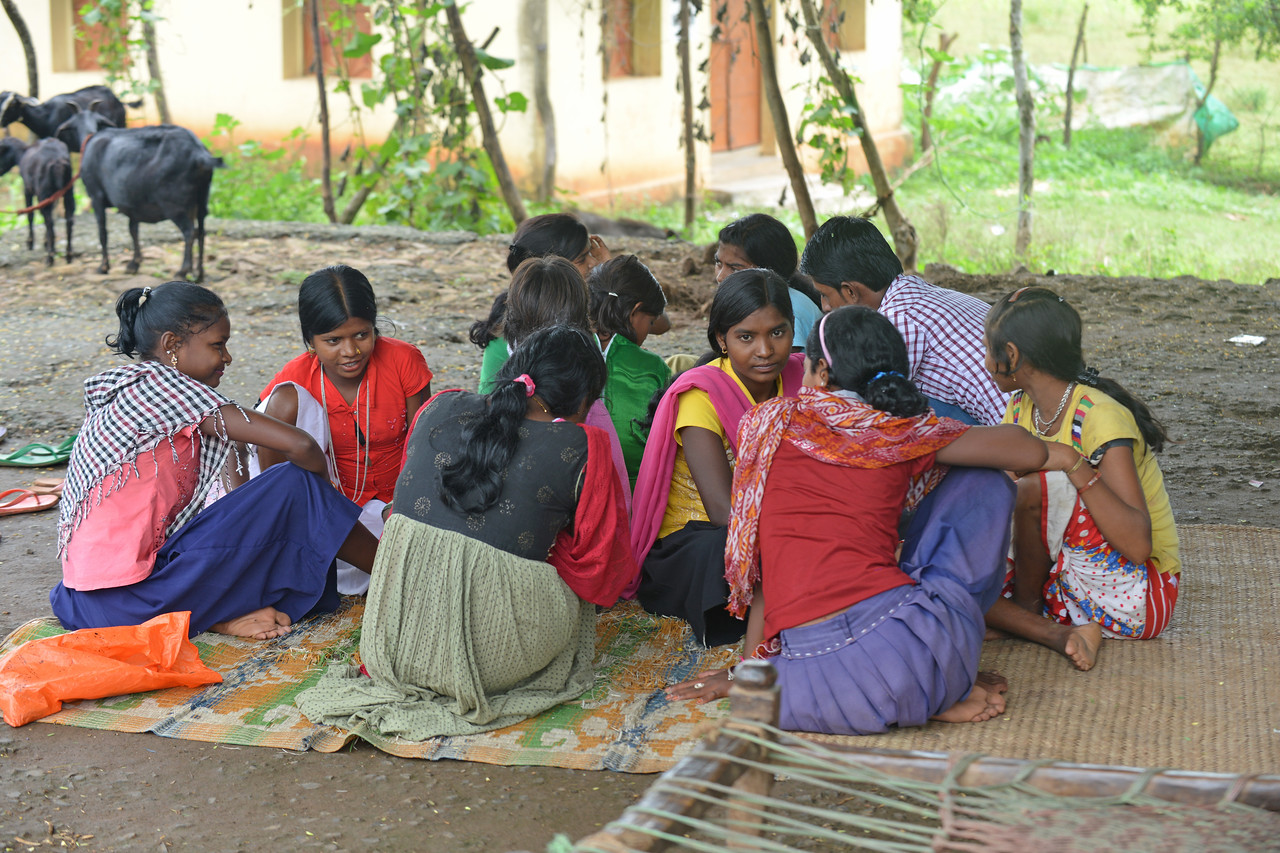 "LGG (Learning Game for Girls) teaching lessons on ""food and flag"" as part of Reach India's session 2 at Shivganga Pahad, Litipada, Dist Pakur.<br /> <br /> Reach India believe that health, hope and dignity are three basic rights for every woman and every family. Even more critical for those living in extreme poverty.<br /> <br /> Reach India's network of local service centres train thousands of local organisations, which in turn train millions of women and girls in self-help and other community groups. Reach's interactive training provides vital information on health, livelihoods and family finance to women and adolescent girls as part of their regular group meetings. By supporting self-help groups and the many organisations that serve them, Reach empowers women and girls to make positive changes in their lives, families, and communities."