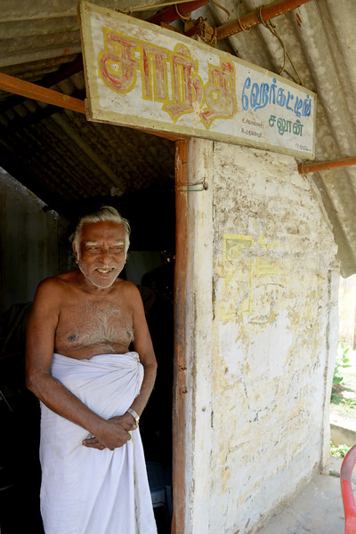 Patient running a barber shop in the village.<br /> Rising Star Outreach of India, Kancheepuram District, Tamil Nadu, India